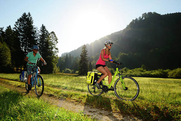 Wall Art - Photograph - Two Cyclists On Gravel Road Chiemgau Oberbayern Germany by imageBROKER - Norbert Eisele-Hein