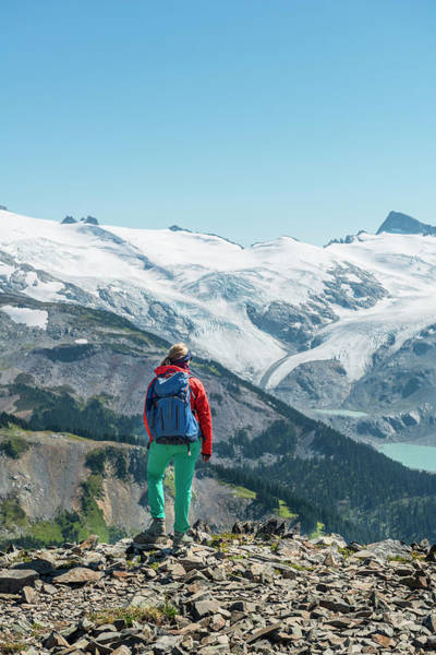 Wall Art - Photograph - View From Panorama Ridge Hiker In Front Of A Mountain Range With Glacier Guard Mountain And by imageBROKER - Moritz Wolf