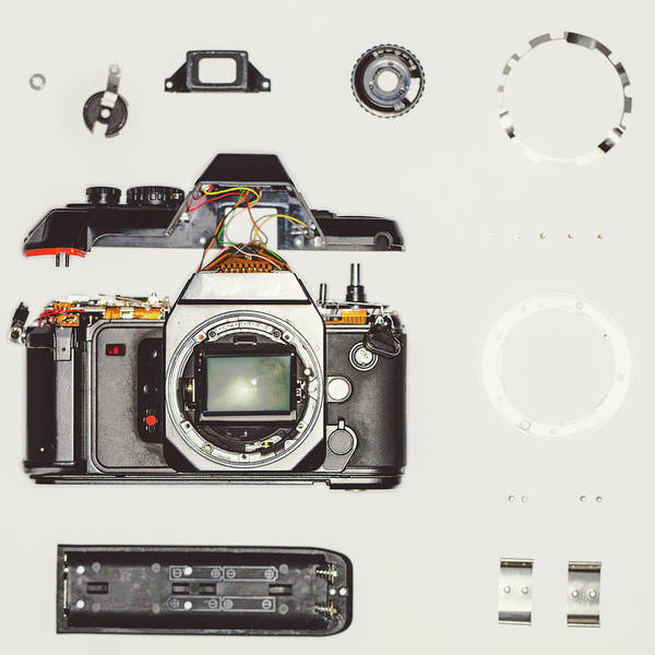 Out Of Focus Wall Art - Photograph - Vintage Disassembled Camera by Deimagine