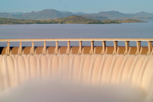 Waters Edge Photograph - Water Flowing Over The Gariep Dam by Emil Von Maltitz