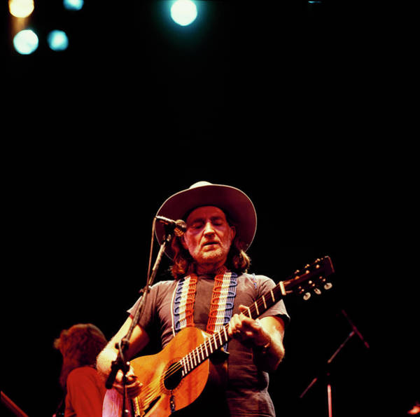 Photograph - Willie Nelson Performs On Stage by David Redfern