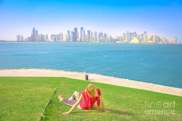 Photograph - Woman Looking Doha Skyline by Benny Marty