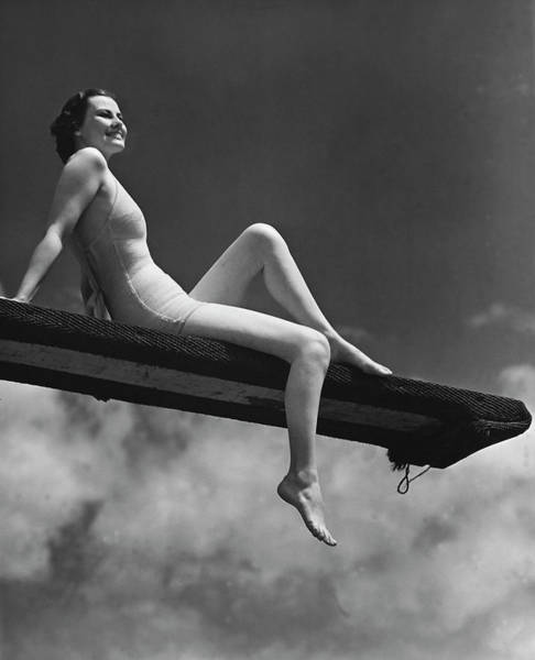 One Piece Swimsuit Photograph - Woman Sitting On Divingboard by George Marks