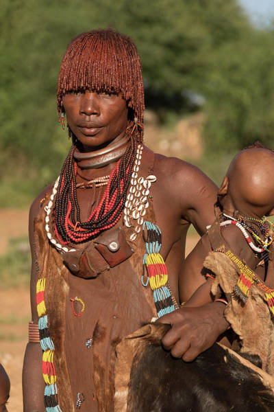 Wall Art - Photograph - Woman With Baby From The Hamer Tribe In Traditional Dress Turmi Southern Nation Region Ethiopia by imageBROKER - Guenter Lenz