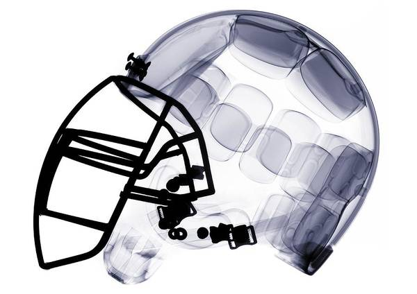 Headwear Photograph - X-ray Of American Football Helmet by Nick Veasey