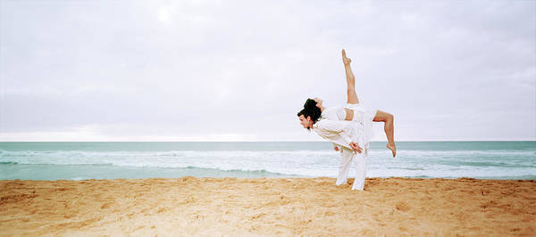 Heterosexual Couple Photograph - Young Couple Dancing On Beach by Matthias Tunger