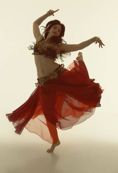 Belly Dancers Photograph - Young Woman Belly Dancing With Red Skirt by Amy Guip