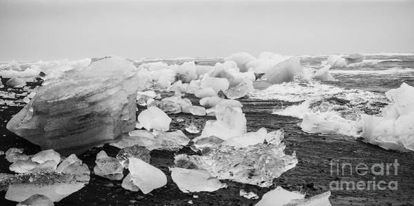 Photograph - Giant Ice Blocks Detached From Icebergs On The Coast Of An Icelandic Beach. by Joaquin Corbalan