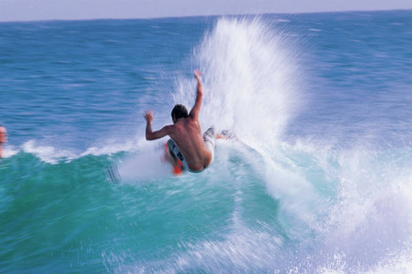 Wall Art - Photograph - Man Surfing In The Sea by Panoramic Images