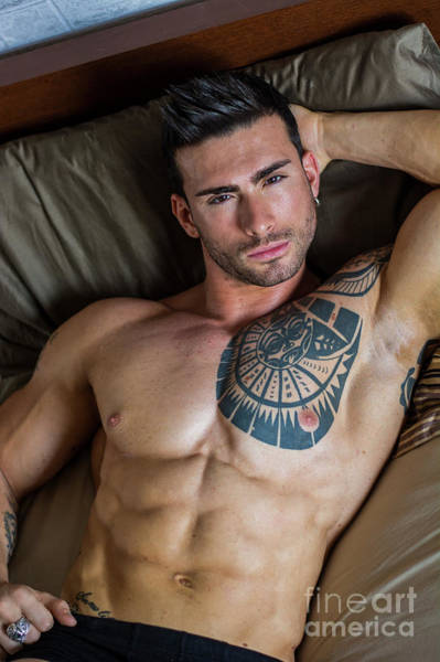 Wall Art - Photograph - Shirtless Sexy Male Model Lying Alone On His Bed by Stefano Cavoretto