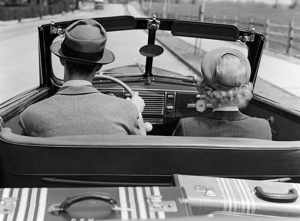 Wall Art - Photograph - 1930s 1940s Rear View Couple Driving by Panoramic Images