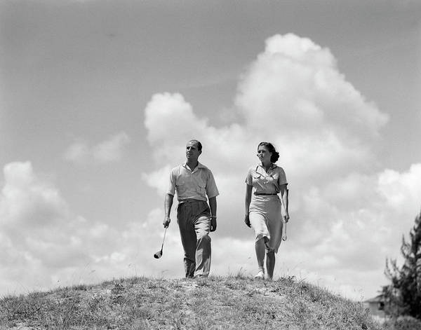 Wall Art - Photograph - 1930s Couple Man Woman Golfers Walking by Panoramic Images