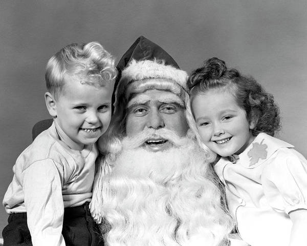Jolly Holiday Photograph - 1940s Man Santa Claus Posing With Young by Panoramic Images