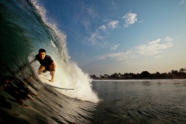 Photograph - A Male Surfer Riding A Red Board Drives by Kyle Sparks