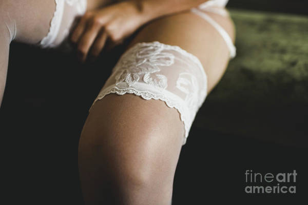 Photograph - Bride Preparing For Her Wedding, Putting On The Garter And Lingerie by Joaquin Corbalan