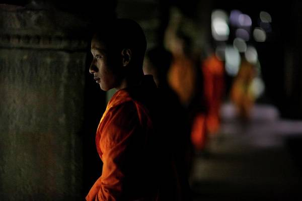 Real People Photograph - Buddhist Monks At Angkor Wat Temple by Timothy Allen