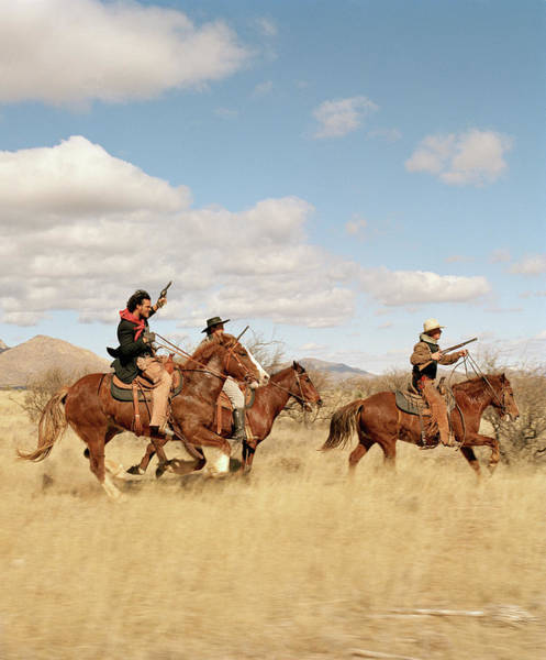 Rifle Photograph - Cowboys Riding On Horses by Matthias Clamer