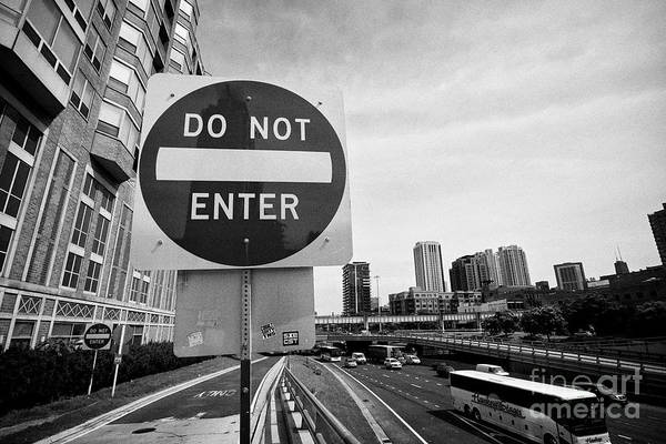 Wall Art - Photograph - do not enter red circle warning sign on an off ramp of the interstate highway in Chicago IL USA by Joe Fox