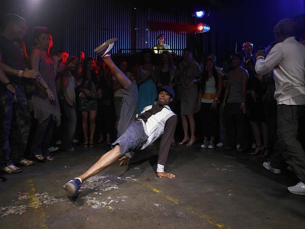 Wall Art - Photograph - Group Of Adults Watching Man Breakdance by Ryan Mcvay