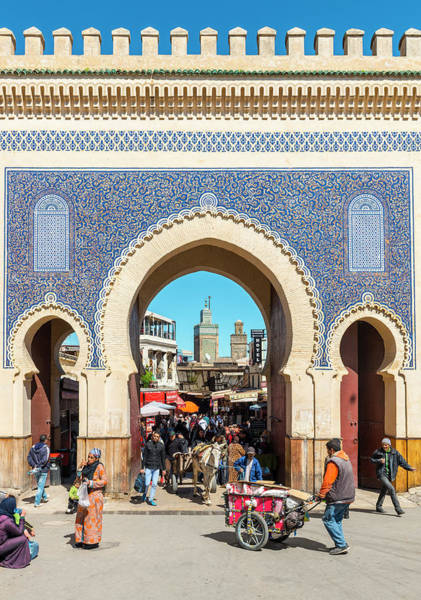 Wall Art - Photograph - Locals In Front Of Bab Boujeloud Blue Gate Of Fes Minaret Of The Madrasa Madrasa Bou Inania Medina by imageBROKER - Moritz Wolf