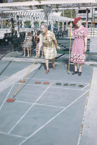Senior Adult Photograph - 2 Old Women Play Shuffle Board, 1940s by Archive Holdings Inc.