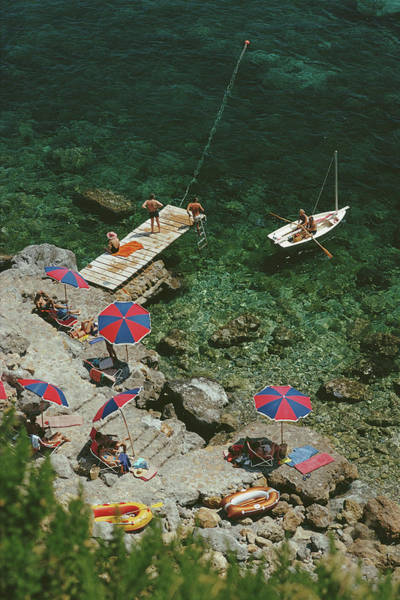 Group Of People Photograph - Porto Ercole by Slim Aarons