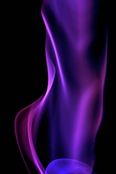 Photograph - Purple Smoke On A Black Background by Gm Stock Films