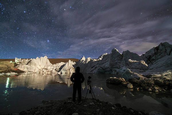 Photograph - The Night Sky Above A Glacier by Jeff Dai