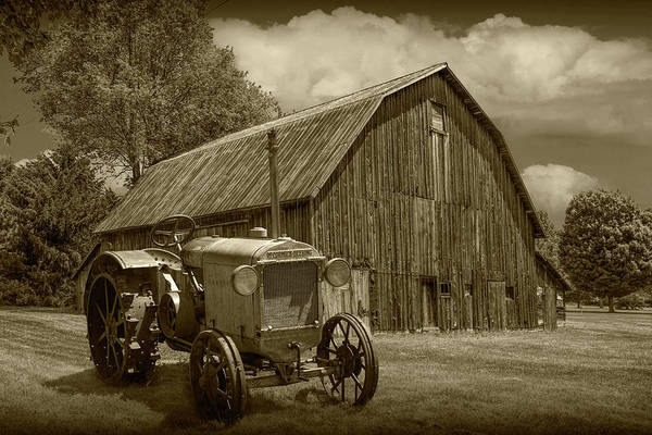 Wall Art - Photograph - Vintage Mccormick-deering Tractor With Old Weathed Barn In A Rus by Randall Nyhof