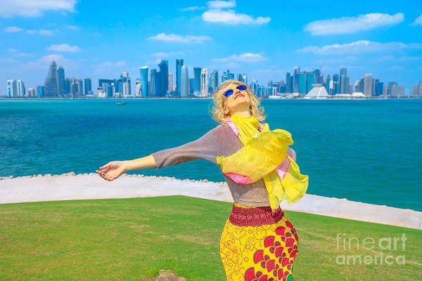 Photograph - Woman At Doha Skyline by Benny Marty