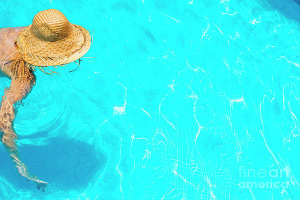 Photograph - Woman In A Pool With Hat Relaxed And Rested. by Joaquin Corbalan
