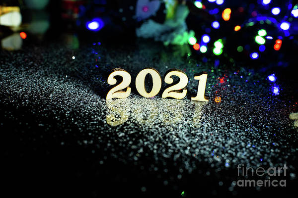 Photograph - 2021 Happy New Year Wood Number Christmas Decoration And Snow With Bright Background And Copy Space by Joaquin Corbalan
