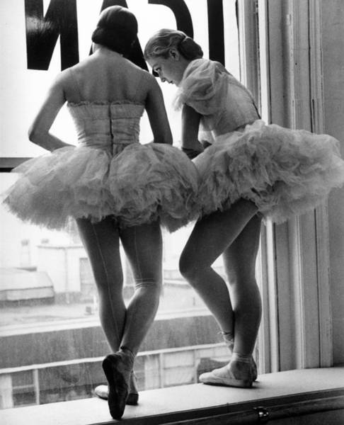 Dancing Photograph - Ballerinas Standing On Window Sill In by Alfred Eisenstaedt