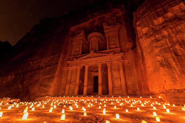 Wall Art - Photograph - Candles In Front Of The Pharaoh S Treasure House Struck In Rock At Night Facade Of The Treasure by imageBROKER - Moritz Wolf