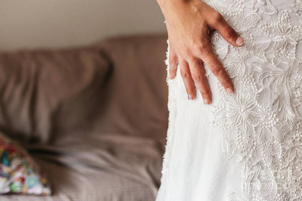 Photograph - Detail Of A White And Elegant Wedding Dress. by Joaquin Corbalan