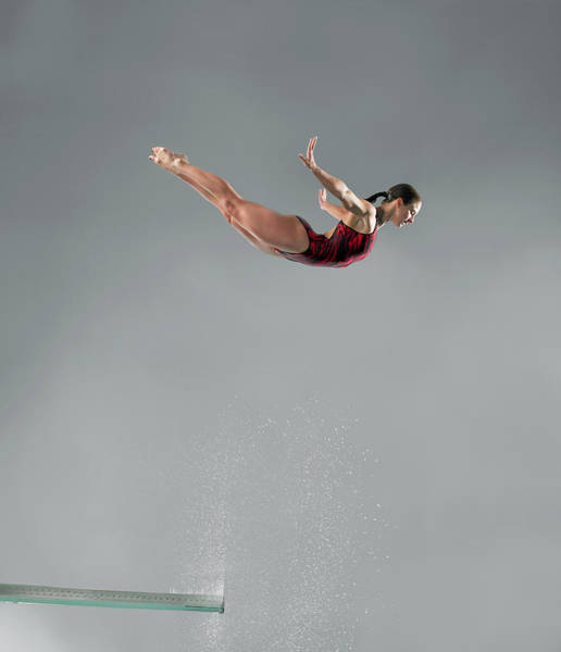 Diving Board Photograph - Diver In Mid-air by Donald Miralle