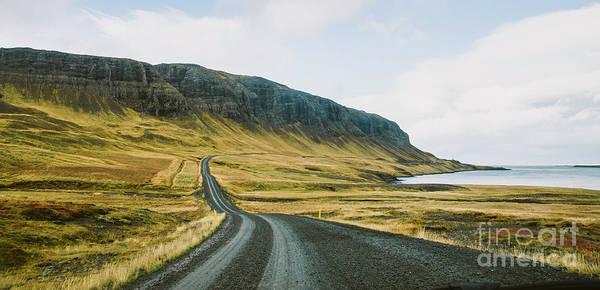 Photograph - Asphalt Mountain Roads Crossing Dangerous Icelandic Passes During A Trip. by Joaquin Corbalan