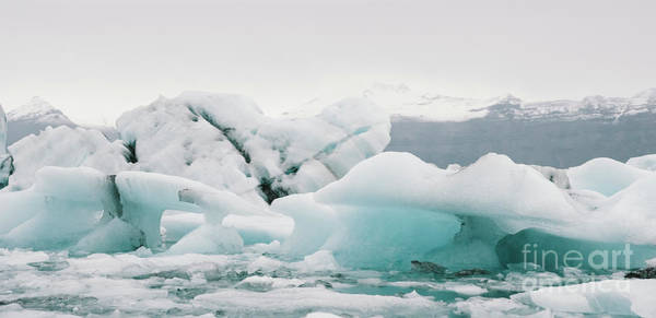 Photograph - Large Icebergs Detached From The Tongue Of A Glacier Reaching The Coast, In Iceland, Paradise For Adventurers. by Joaquin Corbalan