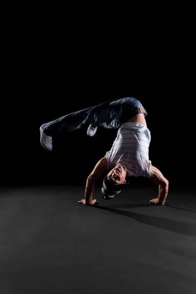 Practice Photograph - A B-boy Doing A Handstand Freeze by Halfdark