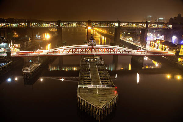 Newcastle Upon Tyne Photograph - A Barge Passing Underneath A Bridge by John Short / Design Pics