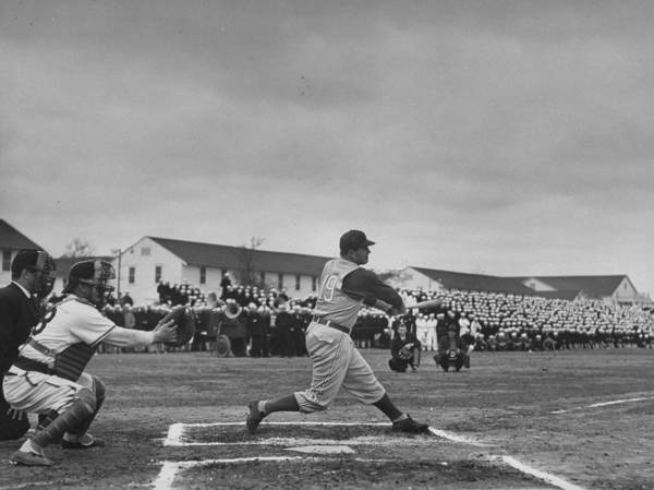 Photograph - A Baseball Player Swinging At A Pitch by William C. Shrout