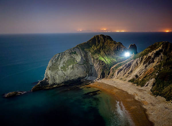 Wall Art - Photograph - A Beautiful Night At Man O War Bay Near Durdle Door, England. by George Afostovremea