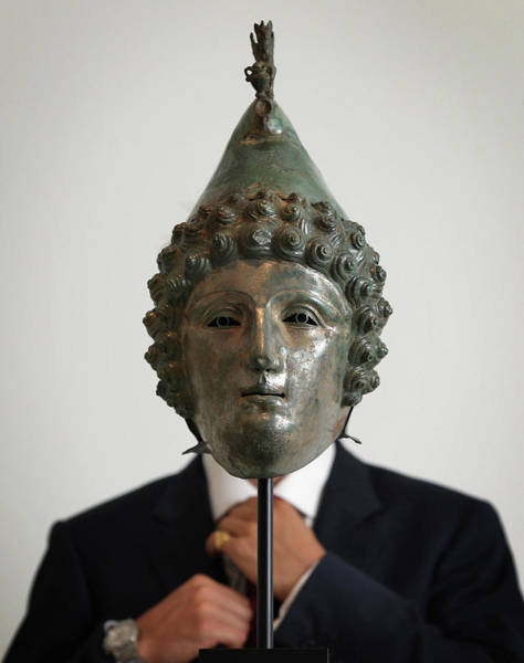 Photograph - A Bronze Helmet Unearthed By A Metal by Dan Kitwood