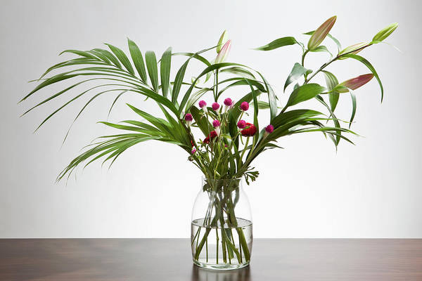 Flowers In A Vase Photograph - A Bunch Of Easter Lilies And Gomphrena by Halfdark