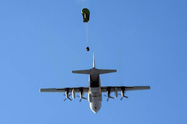 Wall Art - Photograph - A C-130e Releasing Airborne Loads by Daniele Faccioli