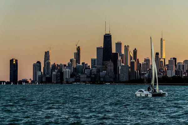 Photograph - A Catamaran At Sunset In Front Of The Chicago Skyline by Sven Brogren