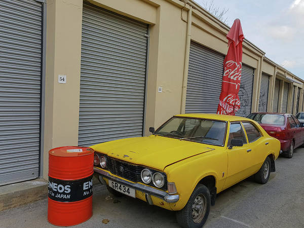 Photograph - A Classic Yellow Ford Cortina by Iordanis Pallikaras