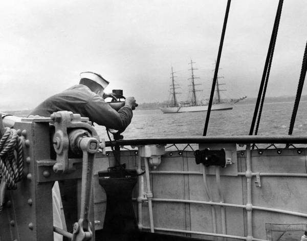 Arrival Photograph - A Coast Guard Cadet Takes A Sighting Of by New York Daily News Archive