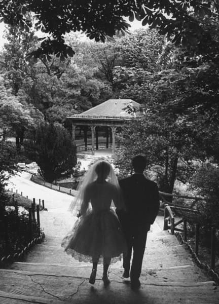 Married Photograph - A Couple Just Married Taking A Walk In A by Loomis Dean