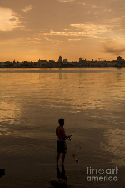Landmark Wall Art - Photograph - A Cuban Fishing Off The City Of Havana by Toniflap